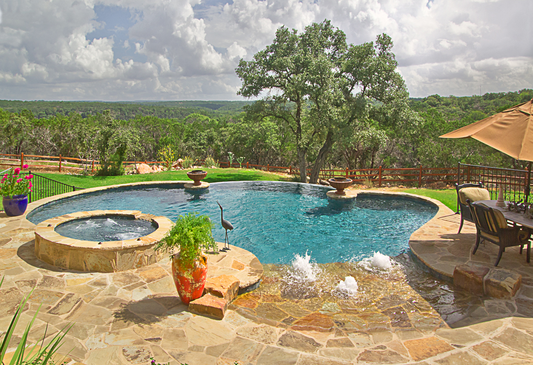 What is an infinity pool keith zars pools san antonio for Country pool ideas